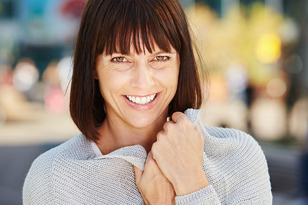 A woman with dental implants showing off a beautiful smile