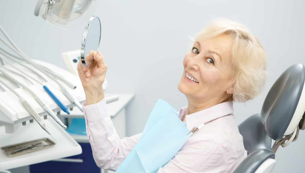 The Benefits of Implant Dentures